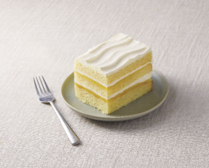 Meyer Lemon cake on plate with fork next to it.