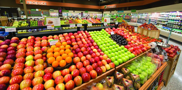 Publix Produce display containing apples and citrus fruits