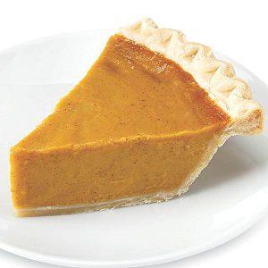 Pumpkin pie on white plate.