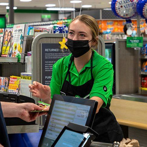 Publix cashier at checkout.